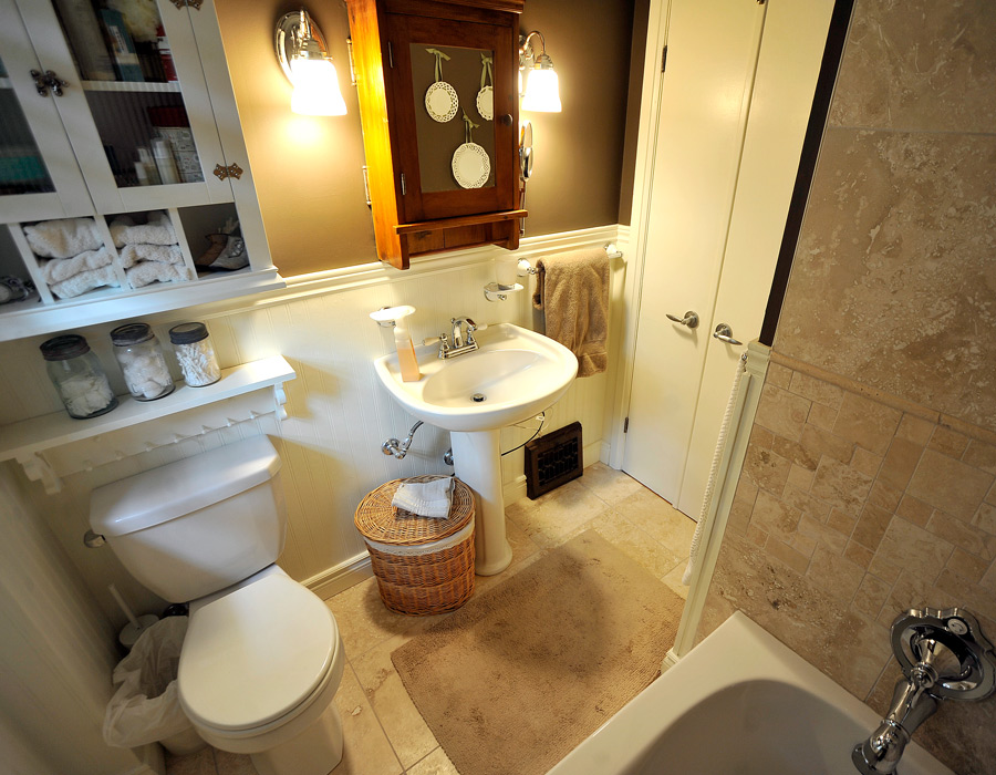 small bathroom with added bath tube