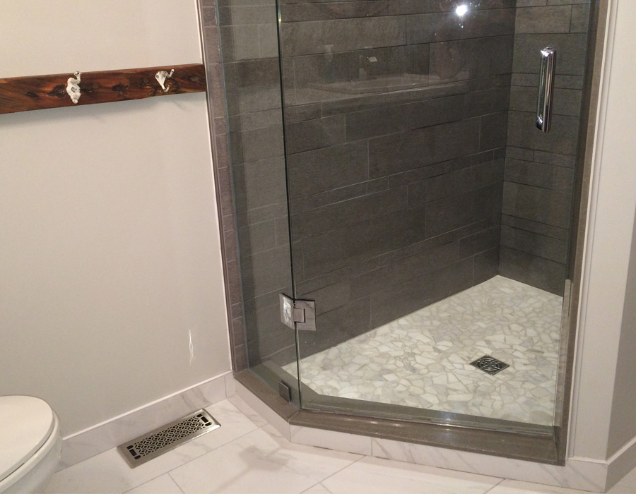 stand-up shower, granite floors and reclaimed wood barn shelf accents