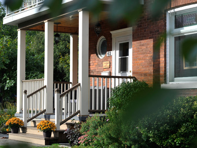 front deck with custom railing on heritage home