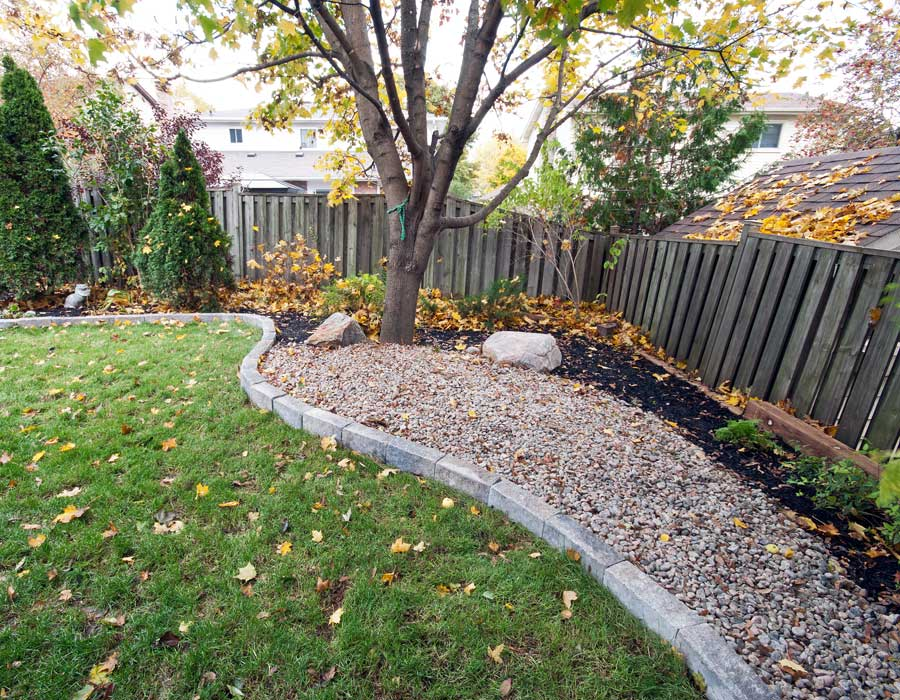 landscaping with sod, stones and black mulch