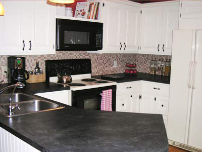 kitchen white cabinets and black countertop